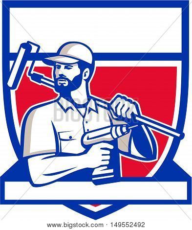 Illustration of a handyman with beard moustache facial hair holding paintroller on shoulder and cordless drill looking to the side set inside shield crest on isolated background done in retro style.