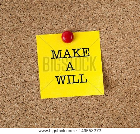 A reminder to Make A Will in red text on a yellow sticky note posted on cork board