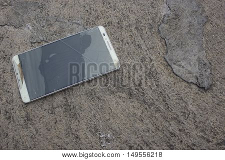 Modern mobile phone with broken screen with selective and soft focus.