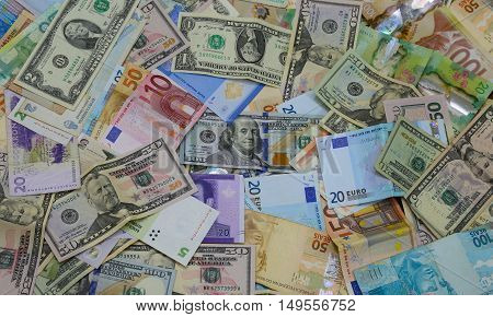 Bank notes from all over the world forming a background