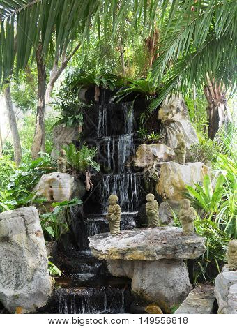nature rock and waterfall garden in house