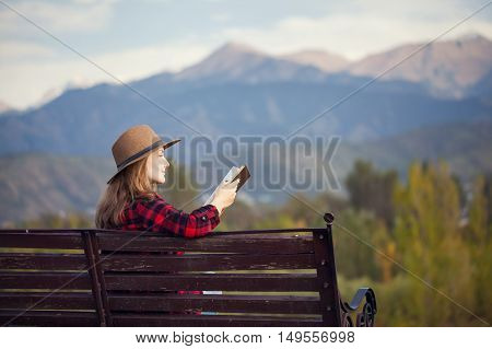 Woman On The Bench With Book