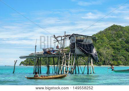 The beautiful sea gypsy water village in Mabul Bodgaya Island in Tun Sakaran marine park,Semporna,Sabah,Borneo,Malaysia.Clear blue water,sand & palm trees.Beautiful vacation spot,treatment & aquatics.