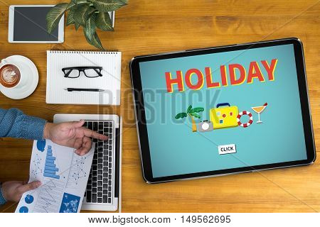 HOLIDAY HOMEPAGE Businessman working at office desk and using computer and objects coffee top view
