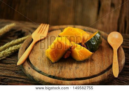 Pumpkin on wooden plate with spoon set, Clean food in dining room for health, Diet food for some people need to burn fat, International food for health with can buy from the market and organic farm.