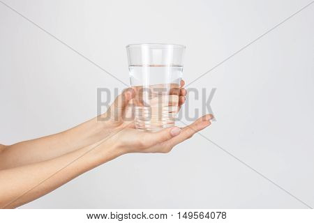 woman giving a glass with water to other