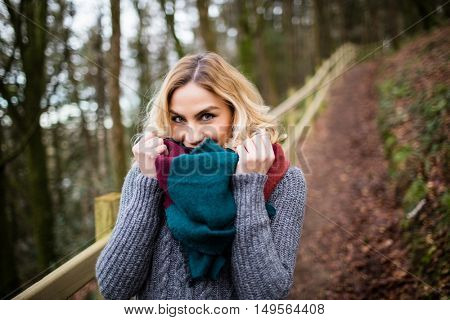 Portrait of beautiful smiling woman in forest