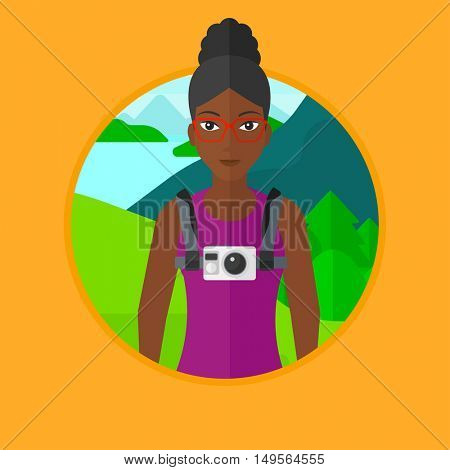 African-american woman with a digital camera on her chest. Tourist with a digital camera standing on the background of mountains. Vector flat design illustration in the circle isolated on background.