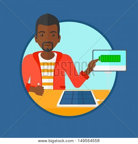 An african-american young smiling man charging tablet computer with solar panel. Charging tablet from portable solar panel. Vector flat design illustration in the circle isolated on background.