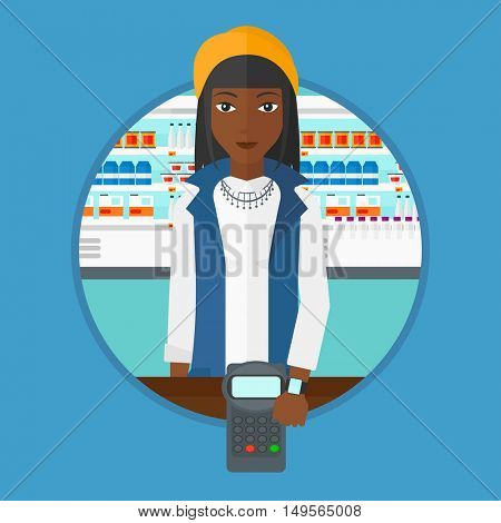 An african woman paying wireless with her smart watch at the supermarket. Customer making payment for purchase with smart watch. Vector flat design illustration in the circle isolated on background.