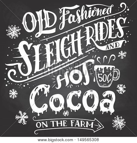 Old fashioned sleigh rides and hot cocoa on the farm. Chalkboard hand-lettering sign. Hand drawn typography with a mug of hot cocoa. Signpost on blackboard background with chalk.