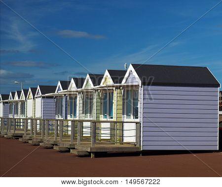 Row of beach huts against a blue sky
