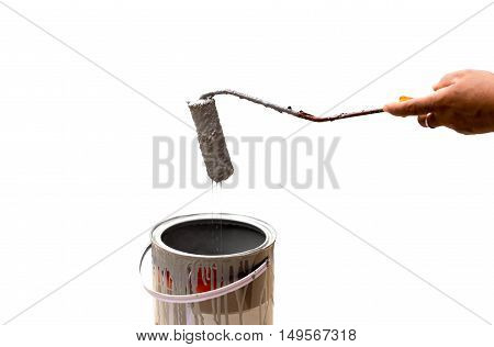 Worker dripping paint with paintroller on construction site in white background