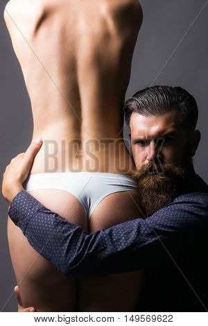 Bearded Man And Female Buttocks