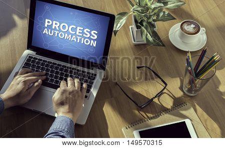 PROCESS AUTOMATION  business man work hard computer