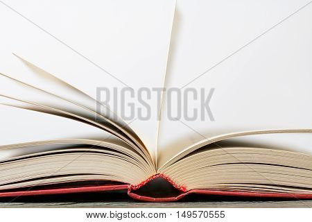 book with a red cover on the table