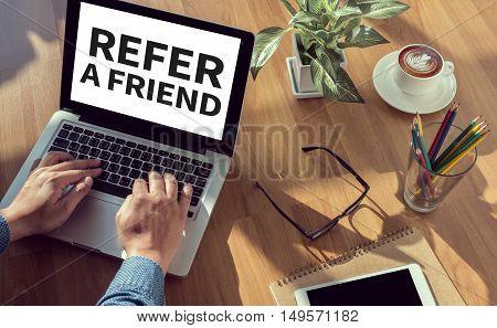 REFER A FRIEND  business man work hard