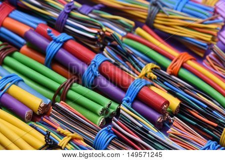 Colored electric wires and computer cables closeup