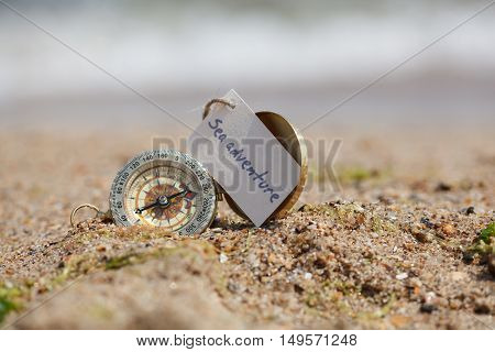 Tourist Compass On The Hot Sand