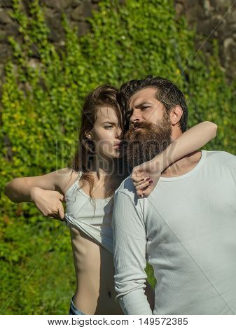 Sexy Young Couple Near Green Leaves