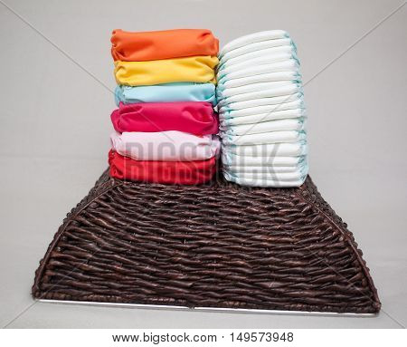 Stacks Of Disposable Diapers And Modern Cloth Diapers