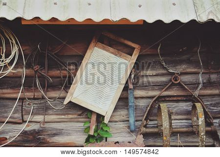 Old metallic wahboard with wooden parts on wooden rustic wall background