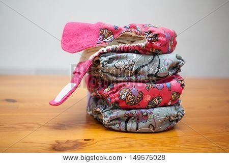 Stack Of Cloth Diapers On A Wooden Table