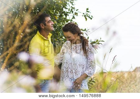 Beautiful Couple Outdoors In A Summer Day