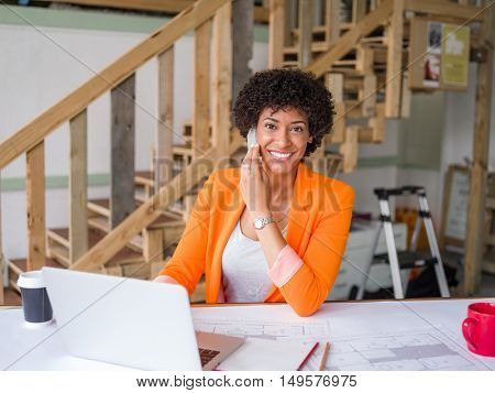 Portrait of young businesswoman with mobile