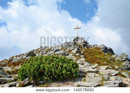 Wooden cross on top of the Predne Solisko peak in High Tatras mountain.