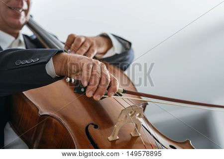 Classical music professional cello player solo performance hands close up unrecognizable person