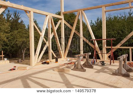 Wooden frame of house under construction.Framed New Construction of a House. Timber house in building process