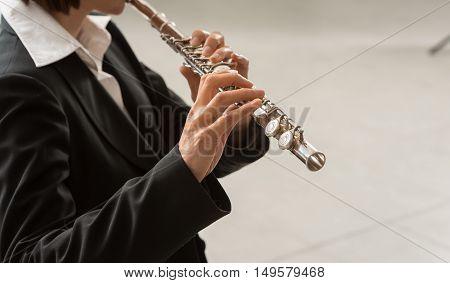 Woman Playing Transverse Flute