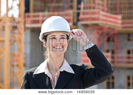 Woman smiling on construction site