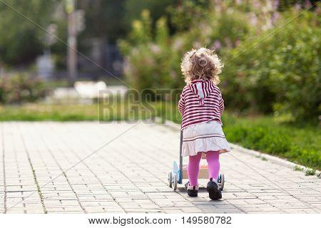 Funny Happy Beautiful Pretty Girl Walking With Toy Pram