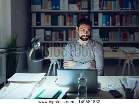 Pensive Man In The Office At Night
