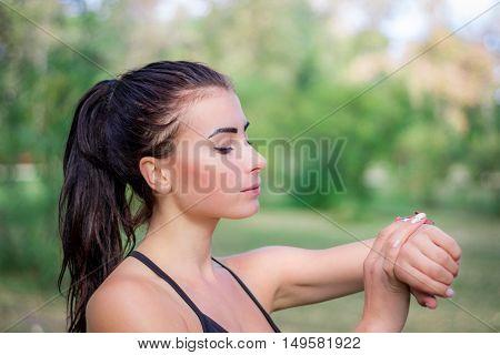 Ftitness Girl Checks Watch Tracker On Her Wrist During Running