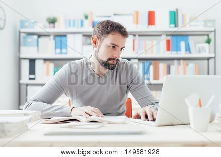 Man Studying And Connecting With A Laptop