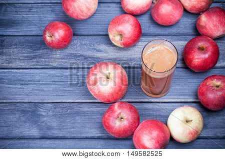 freshly squeezed Apple juice in a glass on dark wooden table vertical photo