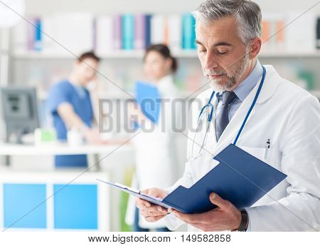 Confident Doctor Checking Medical Records