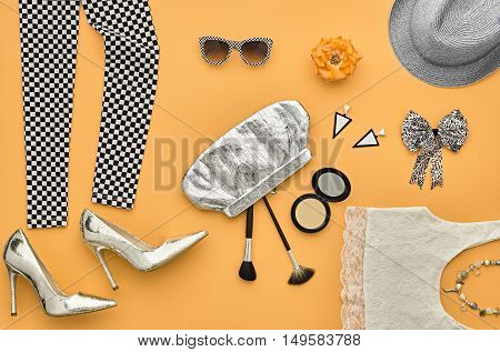 Fashion Design Outfit. Essentials fashion Cosmetic Makeup. Fashion woman Clothes Accessories Set. Stylish Leggings, Glamor fashion Heels, Handbag Clutch, Trendy Sunglasses. Top view. Creative. Minimal