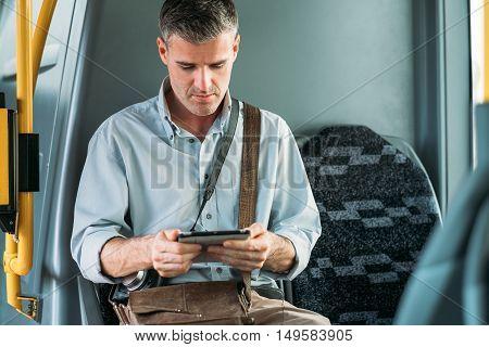 Tourist Using A Digital Tablet
