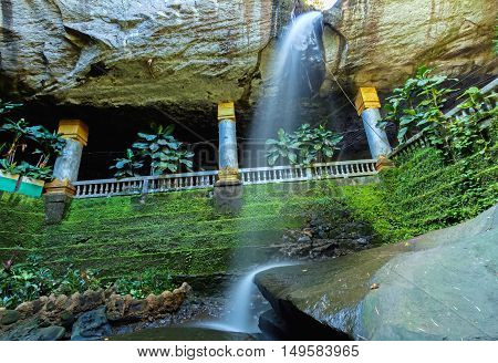 Amazing Thailand the temple under waterfall Wat Tham Heo Sin Chai waterfall. Kaeng Tana National Park Ubonratchathani Thailand