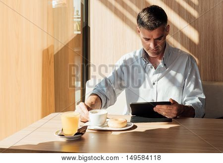 Businessman Relaxing At The Cafe