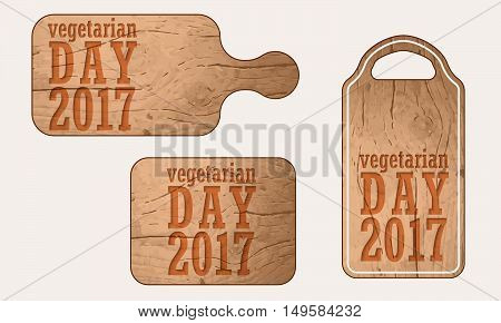 Wooden breadboard with the words world vegetarian day