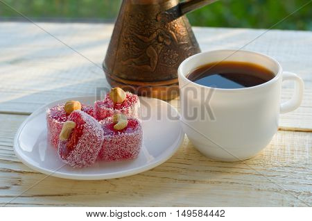 Turkish delight and strong coffee mug into the sunset