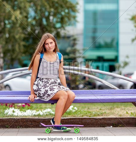 Nice And Fashion Young Woman Posing With Skateboard