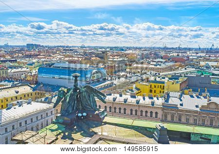 The Colonnade of St Isaac's Cathedral overlooks the roofs of historic city St Petersburg Russia.