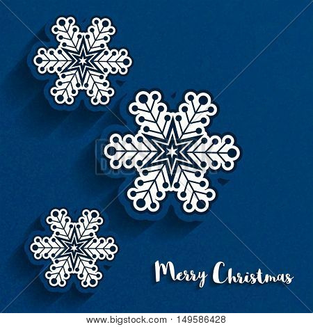 Creative snowflakes on grungy blue background for Merry Christmas celebration concept.