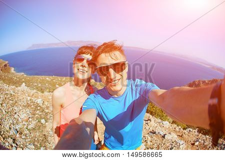 couple on the sea beach at the morning. man taking a selfie